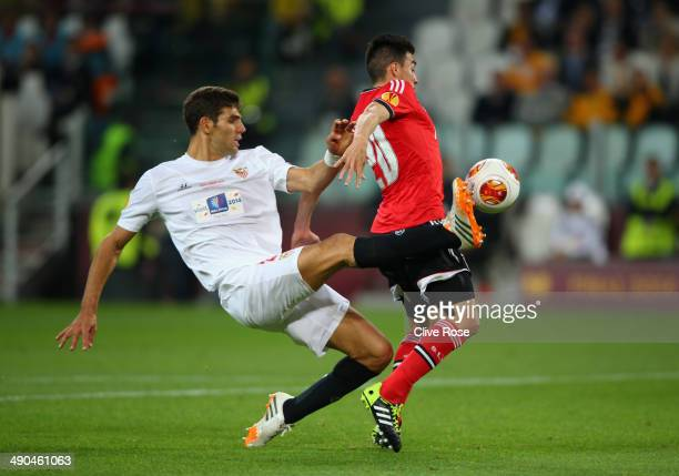 Federico Fazio of Sevilla tackles Nicolas Gaitan of Benfica in the area during the UEFA Europa League Final match between Sevilla FC and SL Benfica...