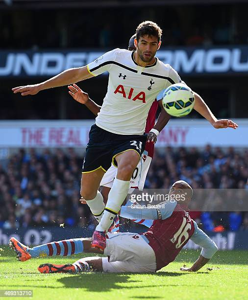 Federico Fazio of Spurs avoids a tackle by Fabian Delph of Aston Villa during the Barclays Premier League match between Tottenham Hotspur and Aston...
