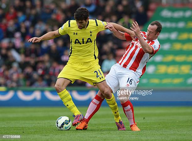 Federico Fazio of Spurs holds off Charlie Adam of Stoke City during the Barclays Premier League match between Stoke City and Tottenham Hotspur at...