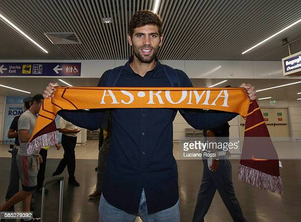 Federico Fazio poses with AS Roma scarf at Fiumicino Airport on August 2 2016 in Rome Italy