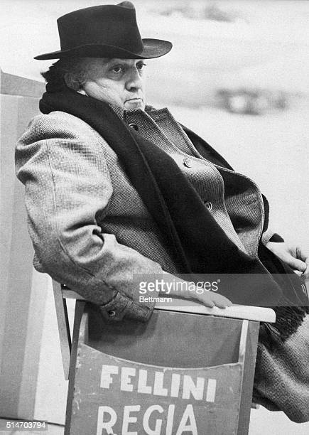 Federico Fellini rests in a chair while filming Amarcord in Rome