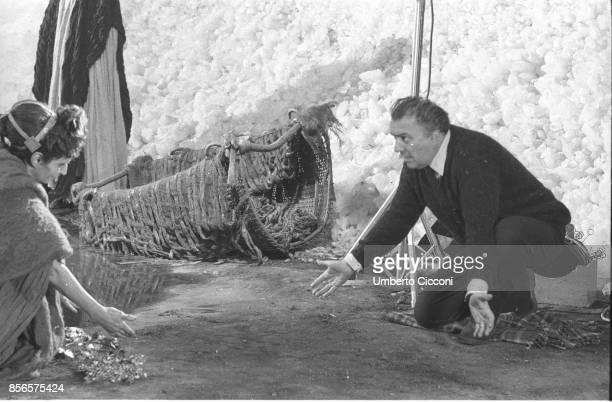 Federico Fellini working with an actress during the movie Satyricon in Cinecittà Studio in Rome 1969