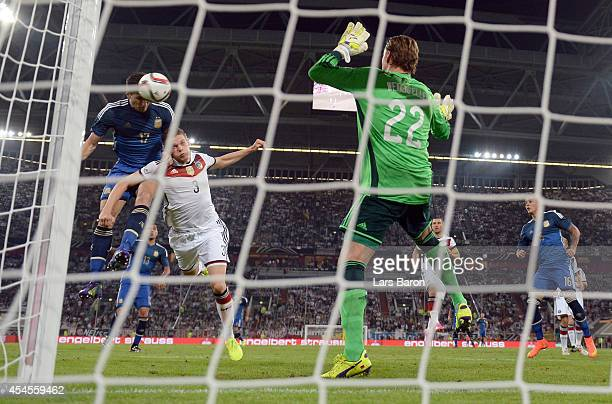 Federico Femandez of Argentina heads his teams third goal against Matthias Ginter and goalkeeper Roman Weidenfeller during the international friendly...