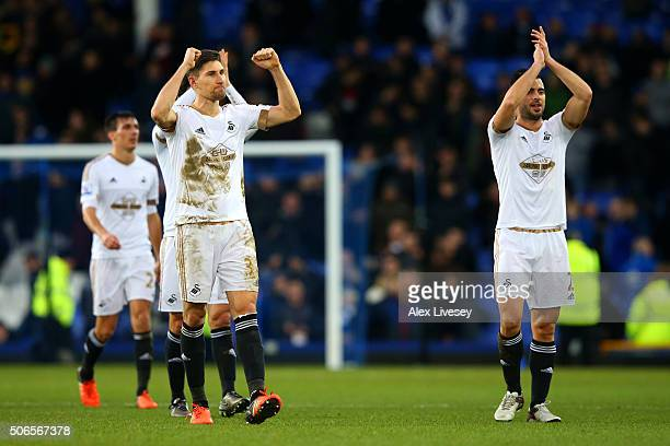 Federico Fernandez and Jordi Amat of Swansea City applaud the fans as they celebrate victory in the Barclays Premier League match between Everton and...