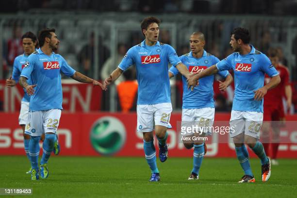 Federico Fernandez of Napoli celebrates his team's first goal with team mates during the UEFA Champions League group A match between FC Bayern...