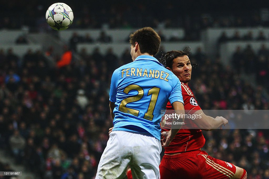 Federico Fernandez (front) of Napoli scores his team's second goal against Daniel van Buyten of Muenchen during the UEFA Champions League group A match between FC Bayern Muenchen and SSC Napoli at Allianz Arena on November 2, 2011 in Munich, Germany.