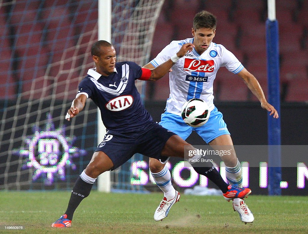 Federico Fernandez (R) of SSC Napoli competes for the ball with <a gi-track='captionPersonalityLinkClicked' href=/galleries/search?phrase=Yoan+Gouffran&family=editorial&specificpeople=534470 ng-click='$event.stopPropagation()'>Yoan Gouffran</a> of FC Girondins de Bordeaux during the preseason friendly match between SSC Napoli and FC Girondins de Bordeaux at Stadio San Paolo on August 1, 2012 in Naples, Italy.