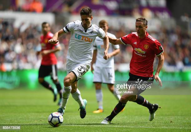 Federico Fernandez of Swansea City and Nemanja Matic of Manchester United battle for possession during the Premier League match between Swansea City...