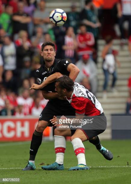 Federico Fernandez of Swansea City challenges Manolo Gabbiadini of Southampton during the Premier League match between Southampton and Swansea City...