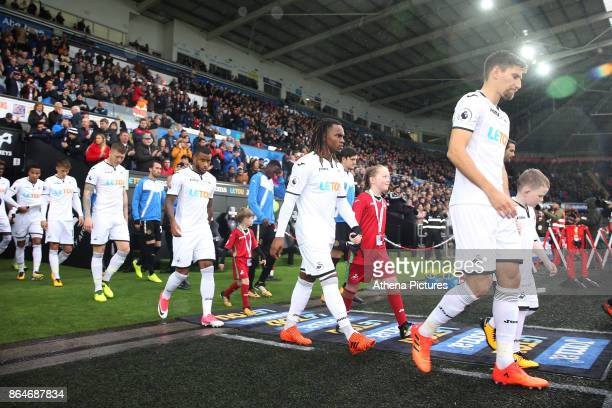 Federico Fernandez of Swansea City Renato Sanches Luciano Narsingh walk out of the tunnel prior to kick off of the Premier League match between...