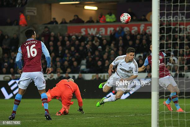Federico Fernandez of Swansea City scores his team's first goal during the Barclays Premier League match between Swansea City and Aston Villa at...