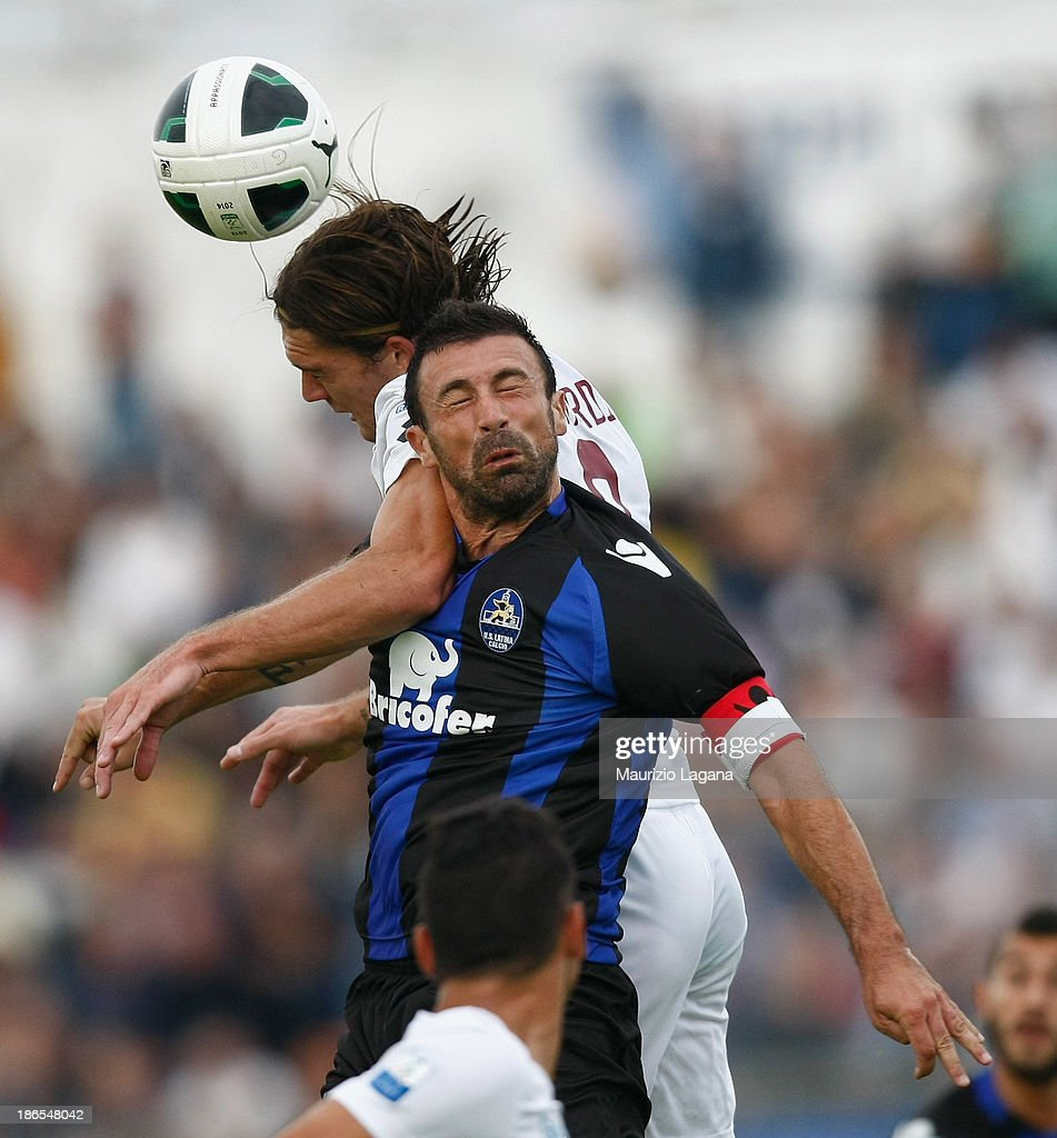 Federico Gerardi (L) of Reggina competes for the ball in air with Marcello Cottafava of Latina during the Serie B match between US Latina and Reggina Calcio at Stadio Domenico Francioni on November 1, 2013 in Latina, Italy.
