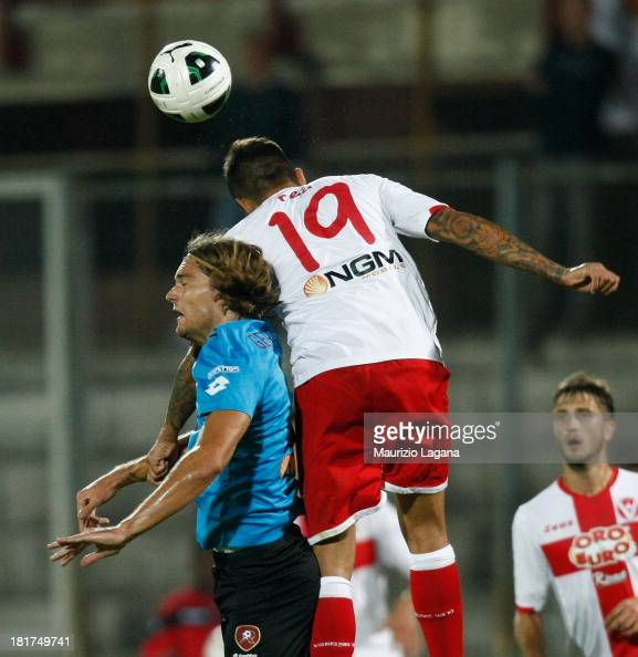 Federico Gerardi of Reggina competes for the ball in the air with Angelo Rea of Varese during the Serie B match between AS Varese and Reggina Calcio...