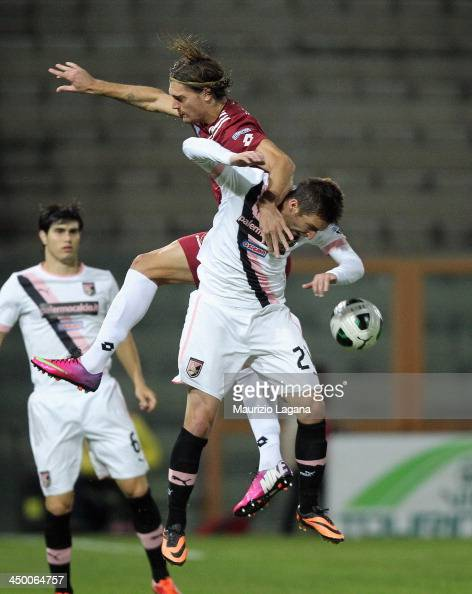 Federico Gerardi of Reggina competes for the ball in the air with Armin Bacinovic of Palermo during the Serie B match between Reggina Calcio and US...
