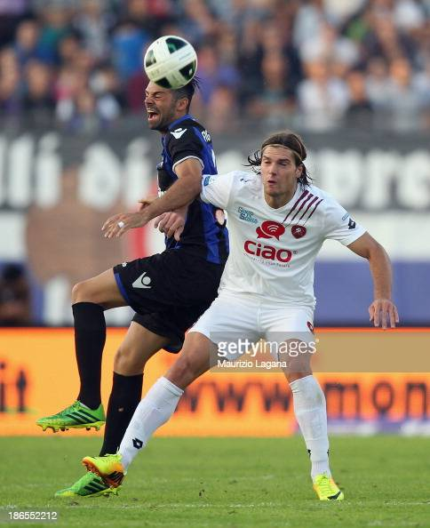 Federico Gerardi of Reggina competes for the ball with Giuseppe Figliomeni of Latina during the Serie B match between US Latina and Reggina Calcio at...