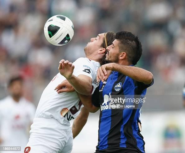 Federico Gerardi of Reggina competes for the ball with Riccardo Brosco of Latina during the Serie B match between US Latina and Reggina Calcio at...