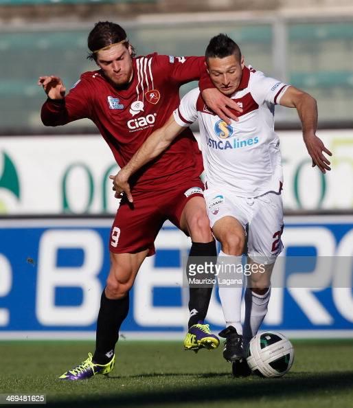 Federico Gerardi of Reggina competes for the ball with Simone Rizzato of Trapani during the Serie B match between Reggina Calcio and Trapani Calcio...