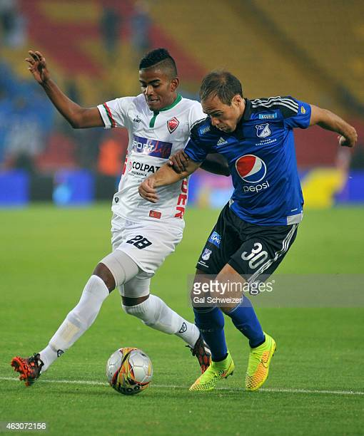 Federico Insua of Millonarios vies for the ball with Raul Loaiza of Patriotas during a match between Millonarios and Patriotas FC as part of second...