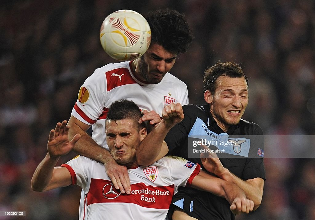 <a gi-track='captionPersonalityLinkClicked' href=/galleries/search?phrase=Federico+Macheda&family=editorial&specificpeople=5621336 ng-click='$event.stopPropagation()'>Federico Macheda</a> and <a gi-track='captionPersonalityLinkClicked' href=/galleries/search?phrase=Serdar+Tasci&family=editorial&specificpeople=787688 ng-click='$event.stopPropagation()'>Serdar Tasci</a> of Stuttgart compete for a header in the air with Libor Kozak of Lazio during the UEFA Europa League round of sixteen first leg match between VfB Stuttgart and Lazio at Mercedes-Benz Arena on March 7, 2013 in Stuttgart, Germany.