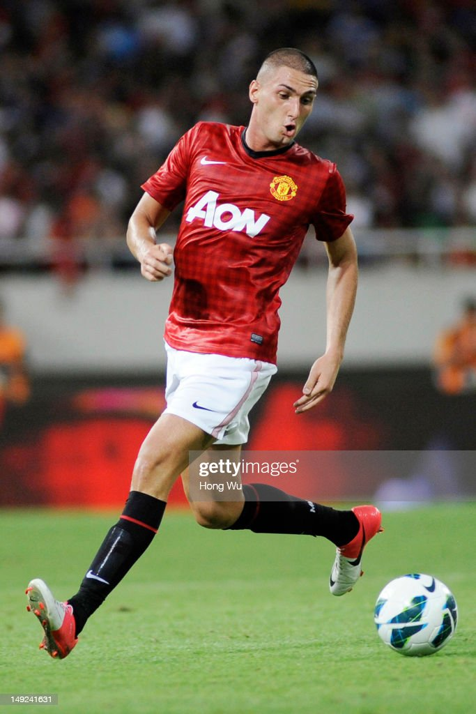 <a gi-track='captionPersonalityLinkClicked' href=/galleries/search?phrase=Federico+Macheda&family=editorial&specificpeople=5621336 ng-click='$event.stopPropagation()'>Federico Macheda</a> of Manchester United controls the ball during the Friendly Match between Shanghai Shenhua and Manchester United at Shanghai Stadium on July 25, 2012 in Shanghai, China.