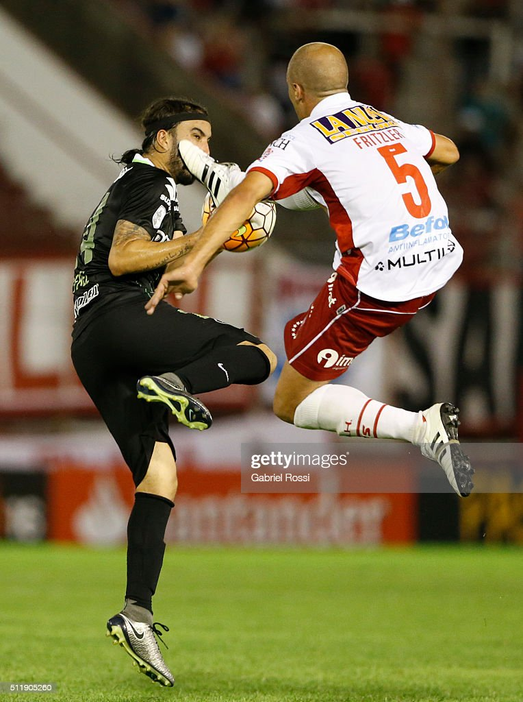 Federico Mancinelli of Huracan (R) fights for the ball with Sebastian Perez Cardona of Atletico Nacional (L) during a group stage match between Huracan and Atletico Nacional as part of Copa Bridgestone Libertadores 2016 at Tomas A. Duco Stadium on February 23, 2016 in Buenos Aires, Argentina.