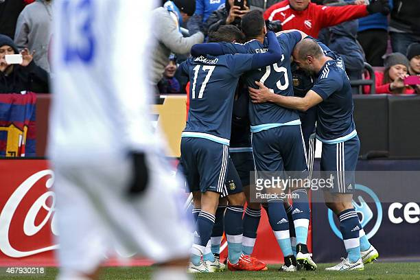 Federico Mancuello of Argentina celebrates his second half goal against El Salvador with teammates during an International Friendly at FedExField on...