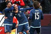 Federico Mancuello of Argentina celebrates his second half goal against El Salvador with teammates Ezequiel Lavezzi and Lucas Orban during an...