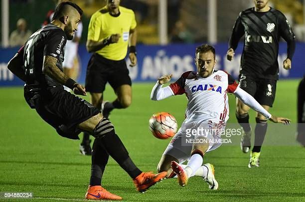 Federico Mancuello of Brazil's Flamengo vies for the ball with Marquinhos of Brazil's Figueirense during their 2016 Copa Sudamericana football match...