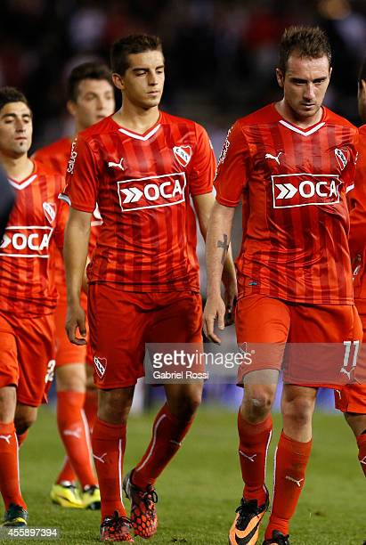 Federico Mancuello of Independiente and teammates leave the fiel at the end of the match between River Plate and Independiente as part of ninth round...