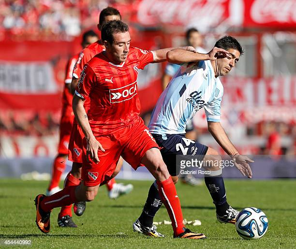 Federico Mancuello of Independiente fights for the ball with Gaston Diaz of Racing Club during a match between Independiente and Racing as part of...