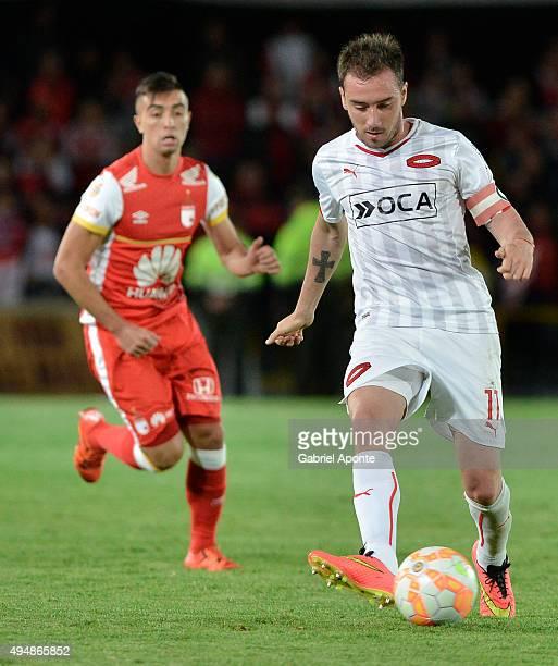 Federico Mancuello of Independiente passes the ball during a second leg Quarter Final match between Independiente Santa Fe and Independiente as part...
