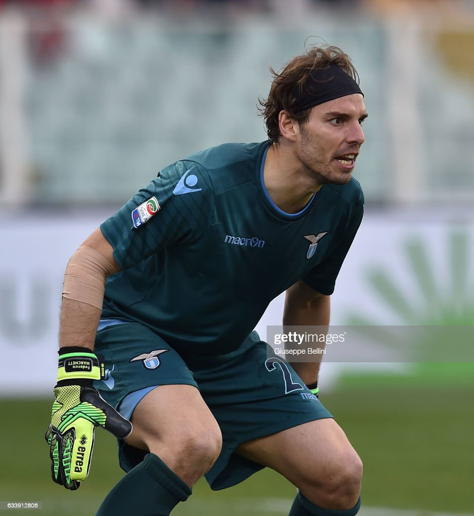 Lazio s midfielder Marco Parolo L eyes the ball during the
