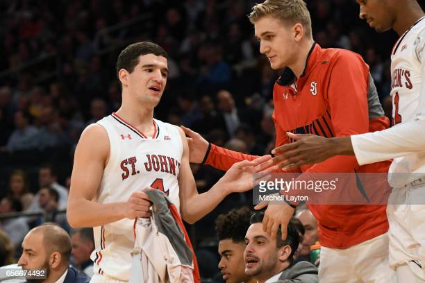 Federico Mussini of the St John's Red Storm comes out of the game during the Big East Basketball Tournament First Round game against the Georgetown...
