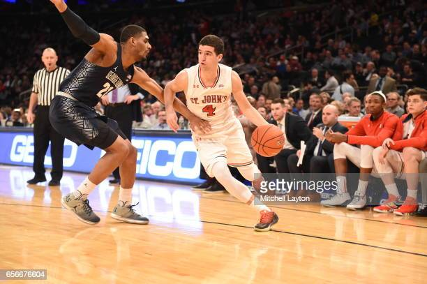 Federico Mussini of the St John's Red Storm dribbles the ball around Rodney Pryor of the Georgetown Hoyas during the Big East Basketball Tournament...