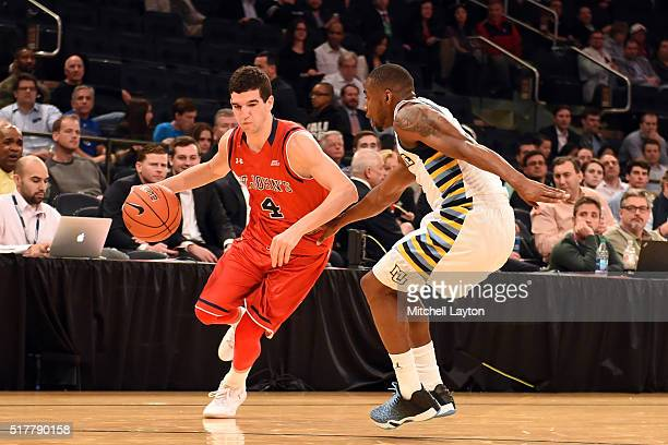 Federico Mussini of the St John's Red Storm dribbles the ball during the first round game of the Big East College Basketball Tournament against the...