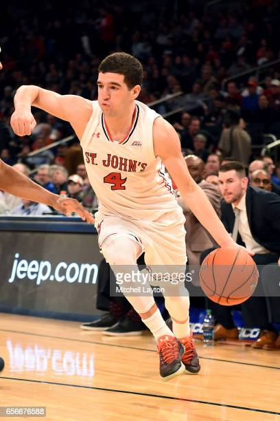 Federico Mussini of the St John's Red Storm dribbles the ball during the Big East Basketball Tournament First Round game against the Georgetown Hoyas...