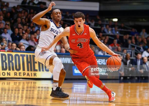 Federico Mussini of the St John's Red Storm drives to the basket against Avery Woodson of the Butler Bulldogs at Hinkle Fieldhouse on February 15...