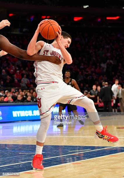 Federico Mussini of the St John's Red Storm grabs the rebound against the Providence Friars at Madison Square Garden on March 4 2017 in New York City...