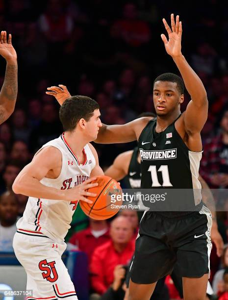 Federico Mussini of the St John's Red Storm is defended by Alpha Diallo of the Providence Friars at Madison Square Garden on March 4 2017 in New York...