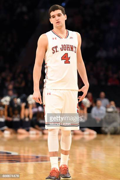 Federico Mussini of the St John's Red Storm looks on during the Big East Basketball Tournament First Round game against the Georgetown Hoyas at...