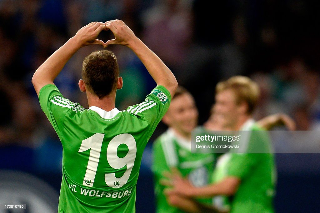 Federico Palacios-Martinez of Wolfsburg celebrates with teammates after scoring his team's second goal during the A Juniors Championships semifinal second leg match between Schalke 04 and VfL Wolfsburg at Veltins-Arena on June 18, 2013 in Gelsenkirchen, Germany.