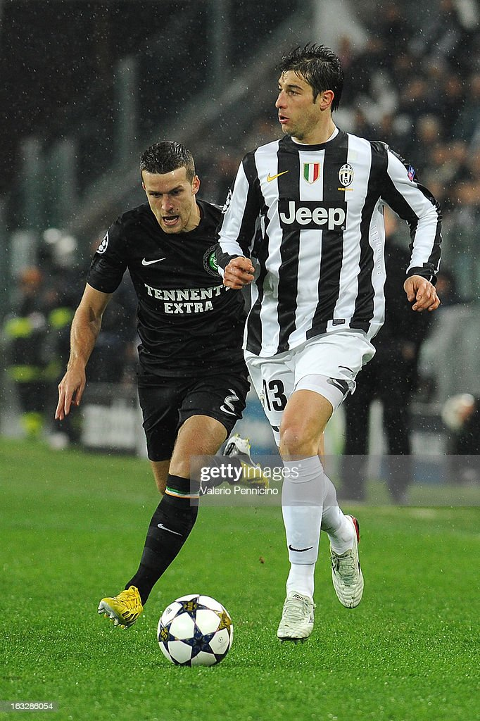 Federico Peluso (R) of Juventus is challenged by Adam Matthews of Celtic during the UEFA Champions League round of 16 second leg match between Juventus and Celtic at Juventus Arena on March 6, 2013 in Turin, Italy.