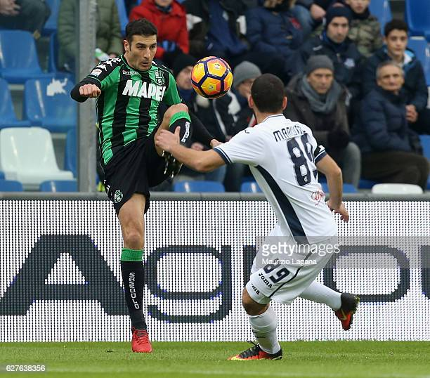 Federico Peluso of Sassuolo competes for the ball with Guido Marilungo of Empoli during the Serie A match between US Sassuolo and Empoli FC at Mapei...