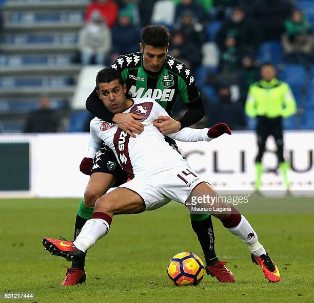 Federico Peluso of Sassuolo competes for the ball with Iago Falque of Torino during the Serie A match between US Sassuolo and FC Torino at Mapei...