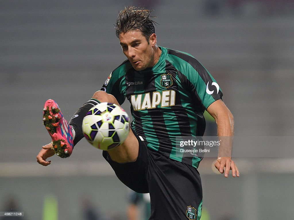 <a gi-track='captionPersonalityLinkClicked' href=/galleries/search?phrase=Federico+Peluso&family=editorial&specificpeople=6336600 ng-click='$event.stopPropagation()'>Federico Peluso</a> of Sassuolo in action during the Serie A match between US Sassuolo Calcio and Empoli FC at Mapei Stadium on October 28, 2014 in Reggio nell'Emilia, Italy.