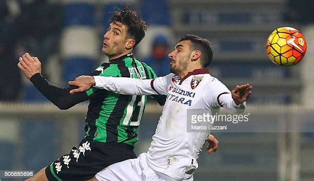 Federico Peluso of US Sassuolo Calcio competes for the ball with Davide Zappacosta of Torino FC during the Serie A match betweeen US Sassuolo Calcio...