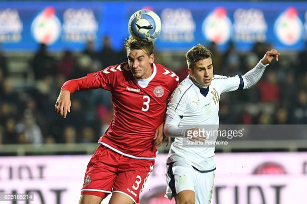 Federico Ricci of Italy clashes with Andreas Maxso of Denmark during the International Friendly match between Italy U21 and Denmark U21 at Stadio...