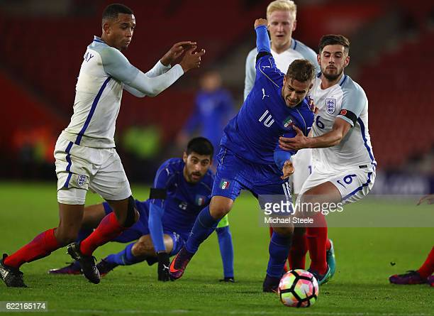 Federico Ricci of Italy cuts between Jack Stephens and Brendan Galloway of England during the FIFA 2018 World Cup Qualifier between England and Italy...