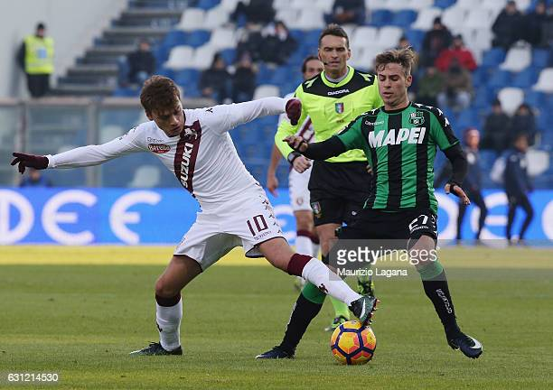 Federico Ricci of Sassuolo competes for the ball with Adem Ljajic of Torino during the Serie A match between US Sassuolo and FC Torino at Mapei...