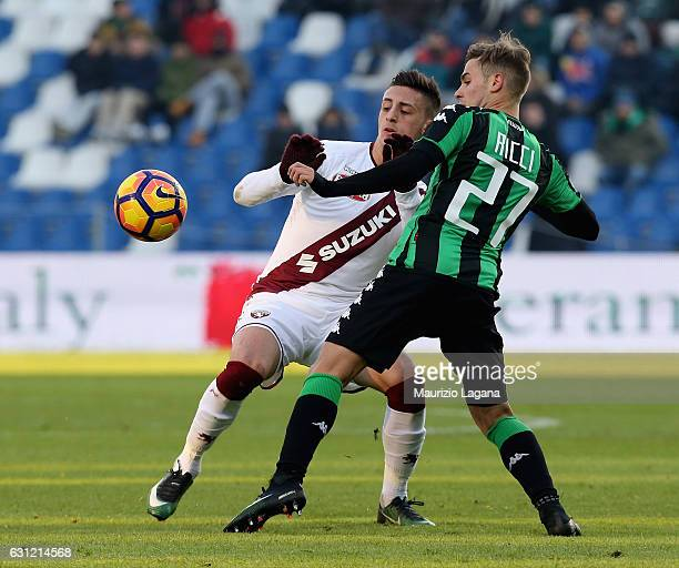 Federico Ricci of Sassuolo competes for the ball with Antonio Barreca of Torino during the Serie A match between US Sassuolo and FC Torino at Mapei...